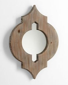 Product Description  A carved washed oak wood frame lines the edges of our Turk Wall Mirror. With its unique shape, this mirror will add visual interest to your space.  Size	17.75HX13.25W  Color	WASHED WOOD  Price	$50