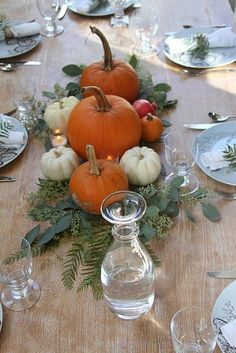 Scatter a variety of pumpkins/gourds/pomegranates in all colors and sizes over fresh greenery.