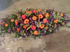 Orange gerbera, orange carnation, purple lisianthus, coffin spray funeral flower spray www.thefloralartstudio.co.uk