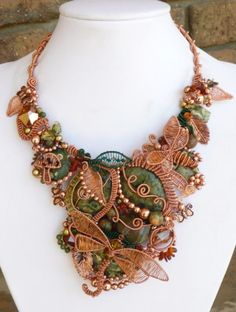 Rainforest - Wirework necklace made from copper, rhyolite, amber, Swarovski crystals by Liz Reed.