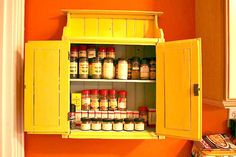 Add a spice cabinet  Add your own spice cabinet by simply refurbishing an old cabinet! Blair, of The Ellwood Avenue Chronicles, sanded and painted an old thift store cabinet and then attached it to the wall!  What you'll need:  Old cabinet Grit paper (to sand) Drill with screws Paint color of choice Dark stain