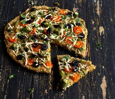 Millet Chickpea Kale Quiche Pizza topped with Okra, golden cherry tomatoes, bell peppers.