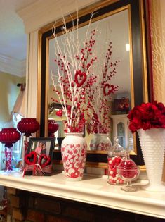Easy Valentine Home Decor that I put together for a friend with what she had on hand. Use what you have. Any kind of red glass or red candle sticks. Tie red hearts or red ribbon at base of a framed picture that you already have on a shelf. Fill glass jars with anything red and shiney or any type of red white or pink candies. White branches and red berries in a vase that already has a touch of red. Make a flower ball by pulling the flower off of the stem and tying together at base and just…