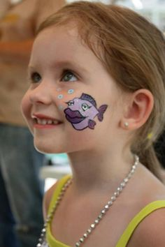 fish face paint:  I like the lips and eye lids.......she looks maaaaaarvelous, darling!