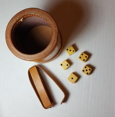 Vintage leather dice cups. Excellent condition with dice and dice holder! Talk about elegant gaming!