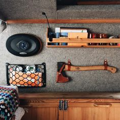 Axe & leather strap storage solutions.                                                                                                                                                                                 More