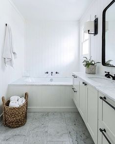 Black, white, and marble in this modern farmhouse bathroom.
