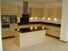 Barnsbury Terrace #kitchen with #downlighting, #marbleworktops & island with a clean sleek look.