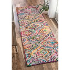 Quality meets value in this beautiful modern area rug. Handmade with polyester and cotton to prevent shedding, this plush area rug will enhance any home decor.