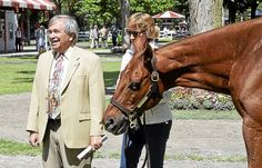 New York-bred Funny Cide, winner of the Kentucky Derby and Preakness Stakes in 2003, poses for a photo with Sackatoga Stable racing manager Jack Knowlton, left, in the paddock at Saratoga Race Course Thursday. Funny Cide is staying at Old Friends at Cabin Creek horse retirement farm for his Saratoga visit. David M. Johnson - DJOHNSON@DIGITALFIRSTMEDIA.COM