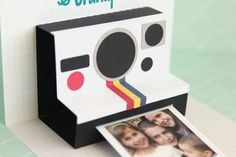 Looking for an eye-catching grandparents' card? I made these camera pop-up cards for my parents with a picture of their grandkids inside as a surprise. The designer has an assembly video tutorial {here} for assembling this card. If you have adhesive cardstock, it's nice to cut the smaller pieces from that and save yourself some gluing. Here's a quick glimpse of which pieces you would cut from adhesive cardstock and which pieces you would cut from regular cardstock: To crop my pict...