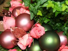 Simple Southern Christmas: Branch makes use of topiaries, green ivy, eucalyptus, pink roses and glass ball ornaments in coordinating colors as key design elements.