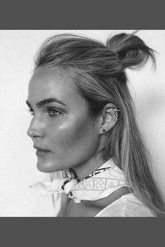 Photos via: Brooke Testoni Australian blogger Brooke Testoni looks as cool as ever with a half-up top knot, bold brows, statement ear cuff, and a chic neck scarf. Those brows! Get the look: + Glossier