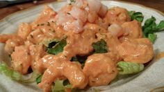 Shrimp Remoulade - cold cooked shrimp dressed up with a tangy remoulade sauce and served over a bed of lettuce.