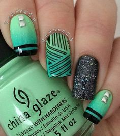 Green and black combination perfect for your winter nail art design. Add details on top using black polish and complete the look with silver embellishments on top.