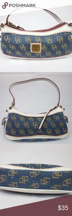 """Dooney & Bourke Zip Top Denim/White Monogram Bag Dooney & Bourke Mini Top Zip Pouch Denim/White Shoulder Bag  There is a small rip on the name tag on the outside. Red in the inside.  White Leather trim with red stitching Classic Brass Front Logo Length 9"""" Height 5"""" Depth 2"""" Strap 8"""" Dooney & Bourke Bags Shoulder Bags"""