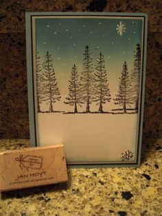 """Graded Wash in Watercolor with Tree Stamps.  Done with a brayer, letting it """"drift"""" the color down the card & using a white gel pen for the snow.  Could also put some glitter on the trees."""