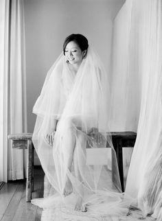 cute bridal boudoir shot: bride wearing just her veil. Image by Jose Villa