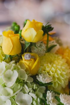 Ring in yellow flowers. Gann Wedding Photos by Photos by Bailey.