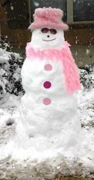 "Snowman or should I say Snow""woman"" decked out in pink"