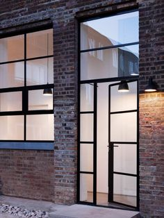 External doors featuring Crittall Windows and a brick courtyard | NONAGON.style