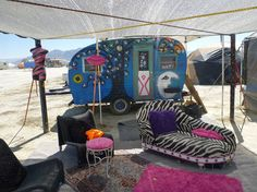 Blue painted caravan with moon, stars, tree and a zebra lounge | At Burning Man Festival |Tiny trailer - vintage caravan <O>