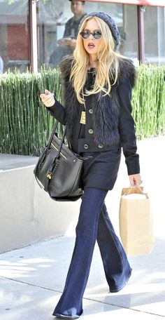 Rachel Zoe is a big fan of the '70s silhouette, and pulls off the flare thanks to a fur-trimmed topper and retro inpsired beanie and Lenin-esque sunnies.                  Source: Splash News Online