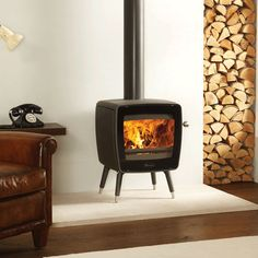 Designed with you in mind the Dovre Vintage 35 wood burning stove has a contemporary design which echoes the smooth, distinctive style. Bell: EST 1898.