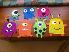 """little felt monsters - going to prep a bunch of """"pieces"""" this summer - and some ideas templates for kids to imitate and copy to get started creating their own monsters ... use when we do Big Green Monster."""