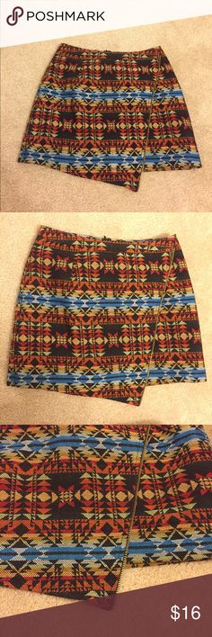 Tribal print mini skirt Tribal print mini skirt. Size small. Multi colored warm tone. Copper zipper on left side that runs diagonal over the length of the skirt. See picture. Thick material. Dressy with heel, or flats/boots festival wear. Skirts Mini