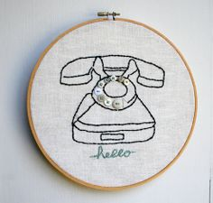 The Plumed Nest: making a light box to copy embroidery designs. Love the button details on this phone