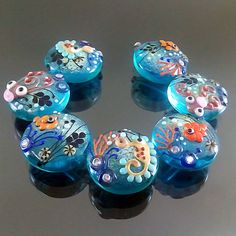 PIKALDA=handmade lampwork 7 glass beads flower blossom sea fish coral=WATER=SRA