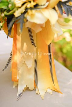 ariella chezar again.... love the scalloped edges on the ribbons... paper cutters are too dull.... gotta research this.