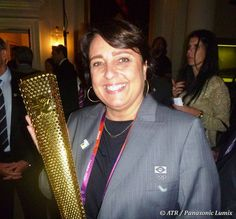 Christiane Paquelet of Rio 2016 with the Olympic torch. (ATR/Panasonic Lumix)