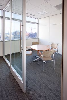First Western Financial   PRODUCT: DIRTT Segmented Glass Meeting Room With Sliding  Barn Door.