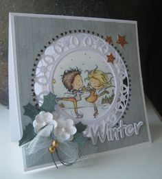 Card by DT member Boukje with Creatables Flower Doily (LR0388), Craftables Winter Wonderland (R1347), Christmas Bells (CR1343) and Punch Die Stars (CR1321) by Marianne Design