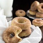 Baked donuts made with cream of tartar (for that signature Snickerdoodle flavor) then brushed with butter and dunked in cinnamon sugar.     Well we've made it through 2015 and come out on the other side. Happy New Year!   I hope you rang in 2016surrounded by those you love best, and maybe a glass or two of something bubbly and perhaps boozy. It's funny how a new year makes us feel like we have a clean slate, and all of those things we wanted to get to in 2015 but didn't quite m...