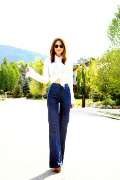 Megan Stewart of Another Day to Dress Up nails the 70s trend with her bell-bottoms and Steve Madden booties.