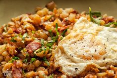 "Cauliflower and Bacon Hash - ""...browns up perfectly in the pan, soaks up the flavor of the bacon and spices, and provides the body and texture that you expect from a real hash."" Low carb"