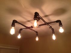 Industrial Steampunk Black Pipe Chandelier by junk2robot on Etsy, $400.00