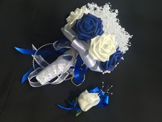 Pretty blue and white real touch roses topped with strings of white pearls to simulate babies breath.