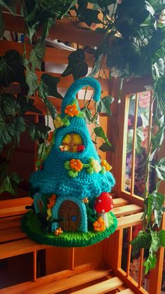 This is a newly made one of a kind crochet fairy or gnome home. Made with cotton and acrylic yarns , my houses are designed to last for many years. This house has a aqua blue roof and a light blue base. Decorated with crochet flowers and beads , windows and mushrooms. This is not to be considered as a toy but for decoration purposes . Stands 12 inches tall. I do not have patterns to sell and I ship within the U.S only. Payments accepted from pay pal only.