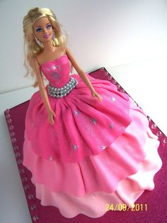 My second Fashion Fairytale cake!  9 inch round and Wilton Doll pan covered with MMF.  TFL.