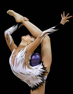 This is EXACTLY like the start of my rhythmic gym routine with the ball I used to have!! :O ! *nostalgic sigh*..