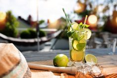 Cocktail Outside Table Stock Photos, Pictures & Royalty-Free Images Little Cottages, Gin Tonic, Mojito, Moscow Mule Mugs, Summer Beach, Royalty Free Images, Lime, Cocktails, Stock Photos