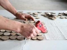 Continue attaching wood slices to the drop cloth using a hot glue gun. Fun Diy Crafts, Wood Crafts, Drop Cloth Tablecloth, Wood Placemats, Wood Shop Projects, Welding Projects, Reclaimed Wood Furniture, Do It Yourself Crafts, Deco Table