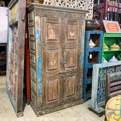 "Oversized Carved Reclaimed Storage Armoire. A true statement piece! Made from a reclaimed door. Item 712261. Measures 51x21x86"". Priced at $1295. - #armoire #storage #storagecabinet #cabinet #statementpiece #rusticdecor #rusticfurniture"