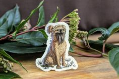 Blonde and Black Brussels Griffon Dog w/Flowers Sticker on Weatherproof Glossy Sticker Paper Height: Inches; Width: Inches Stickers are sold individually or in packs of 3 and 10 Product specs: Griffon Dog, Brussels Griffon, Golden Blonde, Glossier Stickers, Lion Sculpture, Beige, Statue, Creative, Dogs