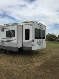 2014 Used Open Range Light 318RLS Fifth Wheel in Oklahoma OK.Recreational Vehicle, rv, 2014 Open Range Light 318RLS, 5th Wheel Travel Trailer: 2014 Open Range Light 318RLS. Trailer is made to be pulled with a half-ton pickup and still maintain a 90 degree turning radius in a 5.5 bed. Opposing rear slides in the living room. Pull-out couch with air mattress, 2 recliners, free standing table with 4 chairs, corner entertainment center with built-in fireplace. Central kitchen with island and…