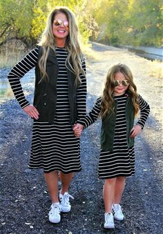 Scroll through the cutest mommy and me outfits and accessories for baby girls and boys, from mommy and me dresses to mother-son matching hats.